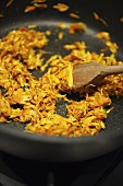 Frying marigolds in frying pan
