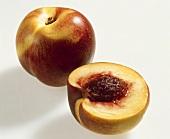 Whole and half nectarine, variety 'Tom Grano'