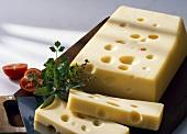 Emmental cheese, a piece cut off