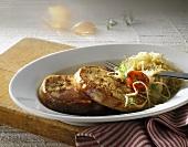 Pfälzer Saumagen (stuffed pig's stomach) with wine sauerkraut