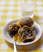 Orange and poppy seed muffins and glass of milk