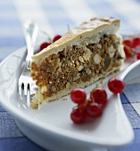 Piece of nut cake with redcurrants