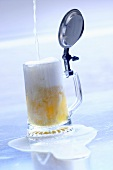 Pouring beer into a tankard