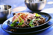 Red mullet fillets with black rice