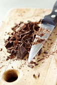 Chopped chocolate on chopping board with knife