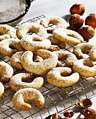 Vanilla crescents with icing sugar on cake rack