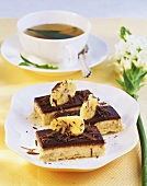 Banana slices with chocolate icing, cup of tea