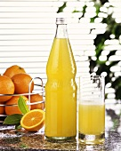 Orangeade in glass and bottle