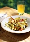 Dandelion salad with bacon and croutons