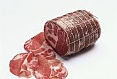 Coppa ham, partly sliced