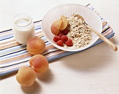 Apricots, raspberries, muesli and yoghurt