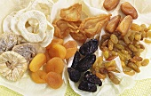 Various types of dried fruit on paper