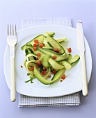 Courgette salad with diced tomatoes and coriander seeds