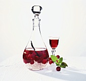 Raspberry liqueur in carafe and glass