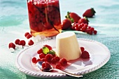 Vanilla blancmange with berries preserved in schnapps