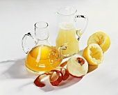 Apple vinegar and lemon vinegar in carafes