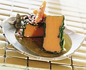 Carrot flan wrapped in spinach