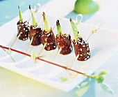 Skewered beef rolls with sesame and spring onions