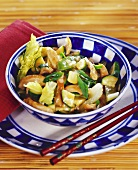 Chicken with vegetables cooked in wok