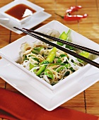 Fried rice noodles with mangetout and sesame