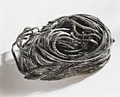 Black ribbon pasta (Nidi di taglierini nero)