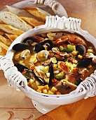 Fish soup with seafood and vegetables, white bread
