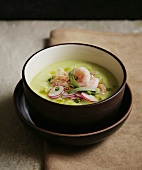 Cucumber soup with shrimps and radishes