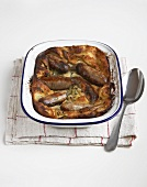 Toad in the hole (sausages baked in batter; England)