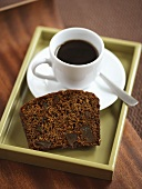 Piece of chocolate cake and cup of coffee