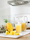 Pineapple juice in glass and jug