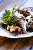 Fried roach in nut sauce with garlic and chillies