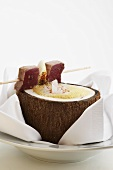 Lemon grass foam soup in coconut with skewered tuna