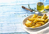 Oven-baked potatoes with thyme, olive oil, lemon (Greece)