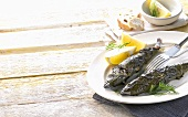 Mackerel, wrapped in vine leaves
