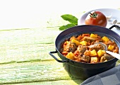 Potato and tomato ragout with meat