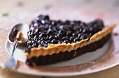 Piece of blueberry tart