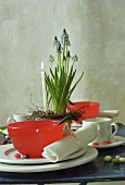 Table laid for Easter with red bowls