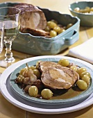 Roast pork with grapes and pearl onions