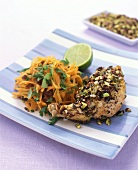 Chicken leg with chopped pistachios and carrot salad