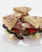 Club sandwiches with chicken, Parma ham and vegetables