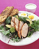 Rocket salad with tandoori chicken, egg and grilled bread