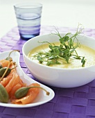 Potato soup with smoked salmon and giant capers