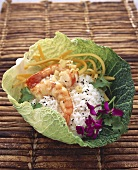 Fried shrimps with rice in savoy cabbage leaf (Asia)