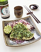 Fish fillet with herbs, lime zest and sprouts (Asia)