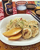Fish cakes with ribbon noodles, coconut sauce & mango (Asia)