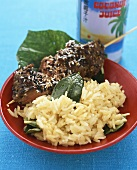 Skewered beef with coconut rice and lemon leaves (Asia)
