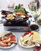 Meat, shrimps and vegetables on table grill (Asia)