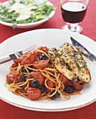 Grilled chicken breast with spaghetti puttanesca (Italy)