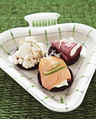 Three pumpernickel slices with smoked salmon, shrimp & reindeer