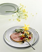 Ham with mustard and honey crust and salad garnish